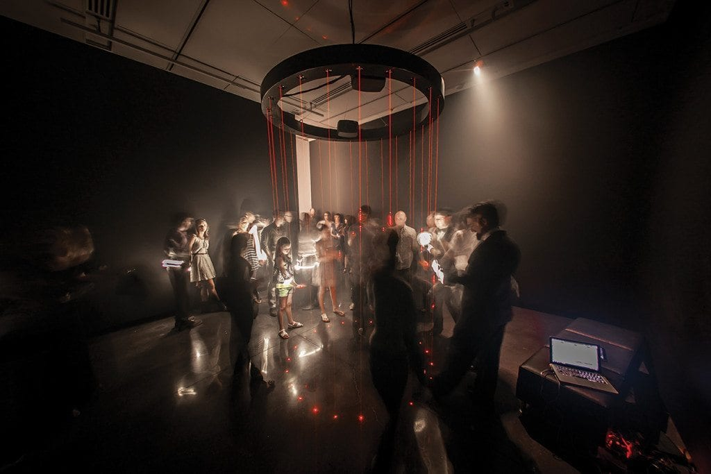The Chandelier Harp, an interactive art installation where passing a hand through a low voltage laser produces a tone, by Jen Lewin Studio at an exhibition in the CU Art Museum. This solo exhibit was titled 'Its Electric' and featured a variety of light and sound based interactive art by artist Jen Lewin.