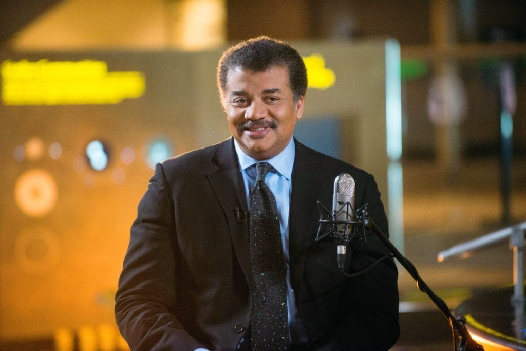 "Neil deGrasse Tyson on the set of his new talk show series ""StarTalk"" filmed with a live studio audience in the Hayden Planetarium at the American Museum of Natural History. ""Star Talk"" premieres on National Geographic Channel in April. (photo credit:  National Geographic Channels/Scott Gries)"