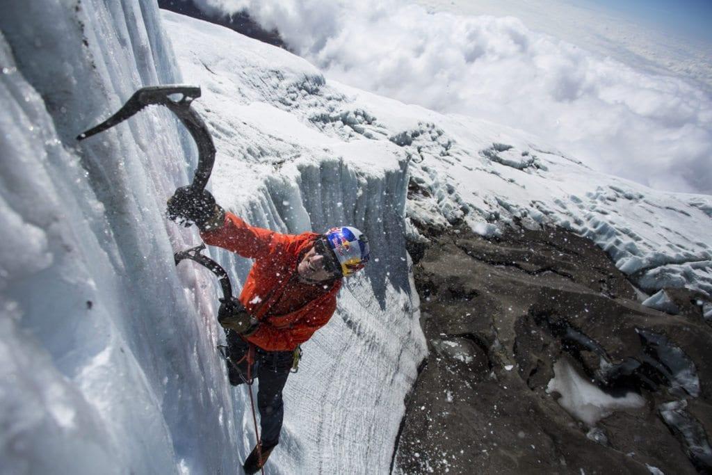 Will Gadd ice climbing near the summit at 19,000 feet on the glacier ice on Mount Kilimanaro in Tanzania, Africa on October 30, 2014.