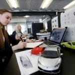 Employees work at office of WayRay innovative high-tech company in Moscow